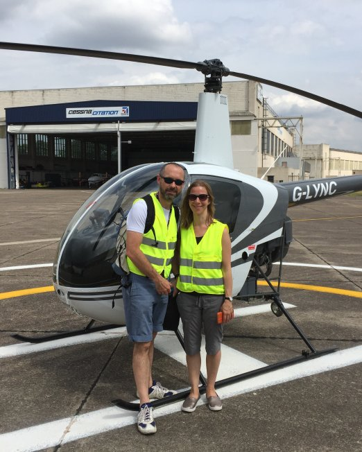 photo in front of r22 helicopter