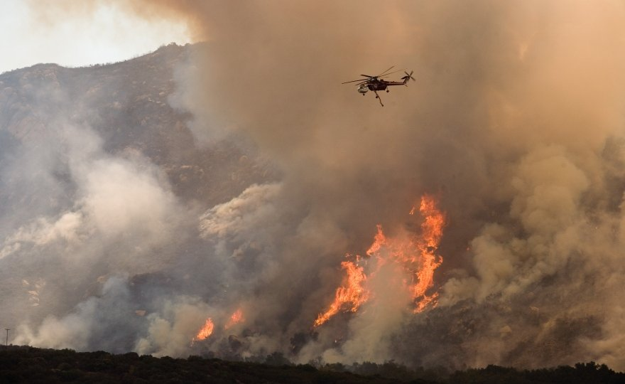 helicopter flying over a fire